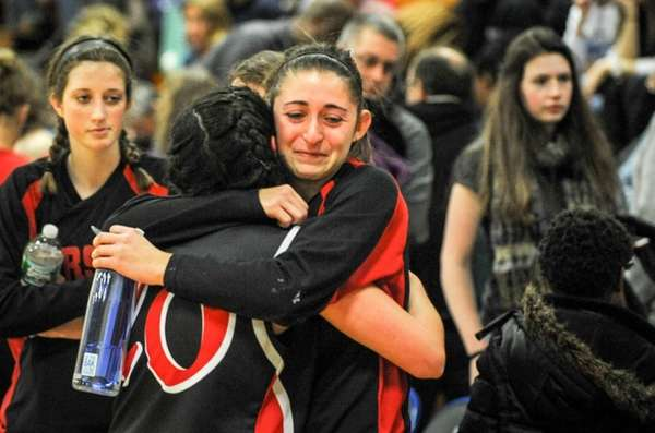 Pierson/Bridgehampton's Katie Kneeland, center, hugs teammate Fallon O'Brien