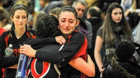 Pierson/Bridgehampton's Katie Kneeland, center, hugs teammate Fallon O'Brien
