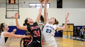 Pierson/Bridgehampton's Katie Kneeland, left, goes up against Pine