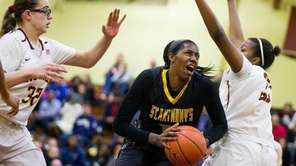 St. Anthony's Jasmine White goes up for a