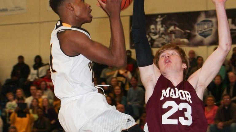 Bridgehampton's Charles Manning Jr goes to the net
