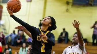 St. Anthony's Taylor Goode shoots against Christ the