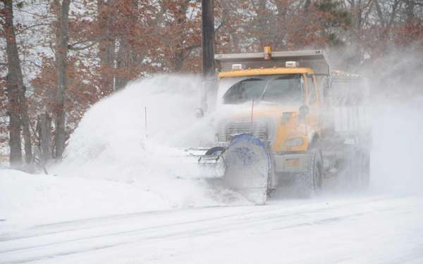 Snow plow at work on CR 51 in