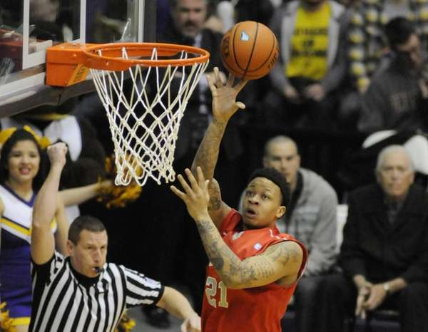 Stony Brook's Rayshaun McGrew scores against Albany during