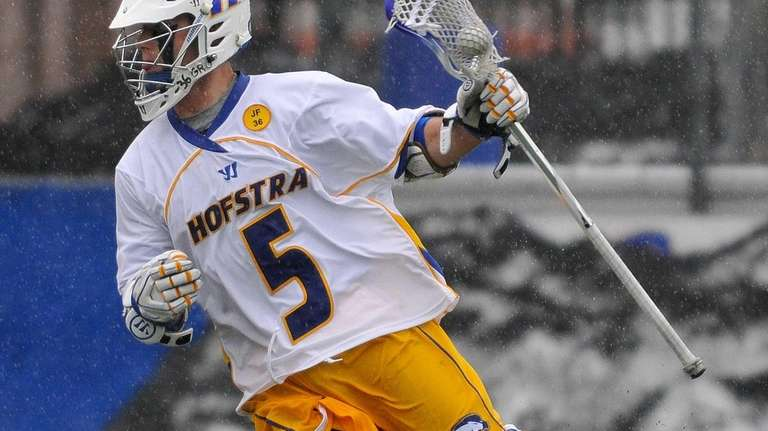 Hofstra University's Sam Llinares carries behind the net