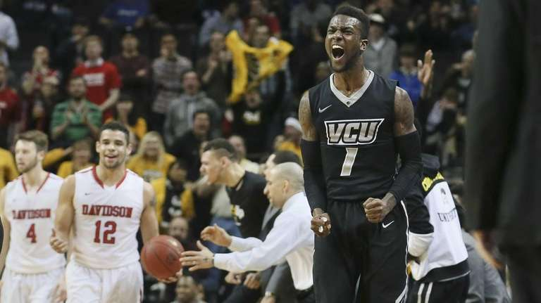 VCU guard JeQuan Lewis reacts as his team