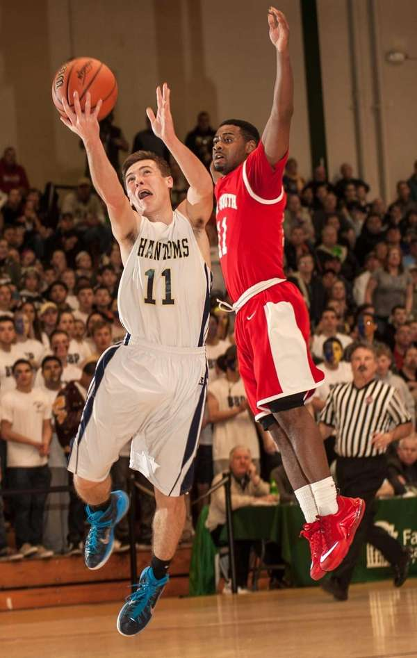 Bayport-Blue Point's Timothy Darby, left, shoots against Valley