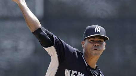 New York Yankees starting pitcher Esmil Rogers delivers