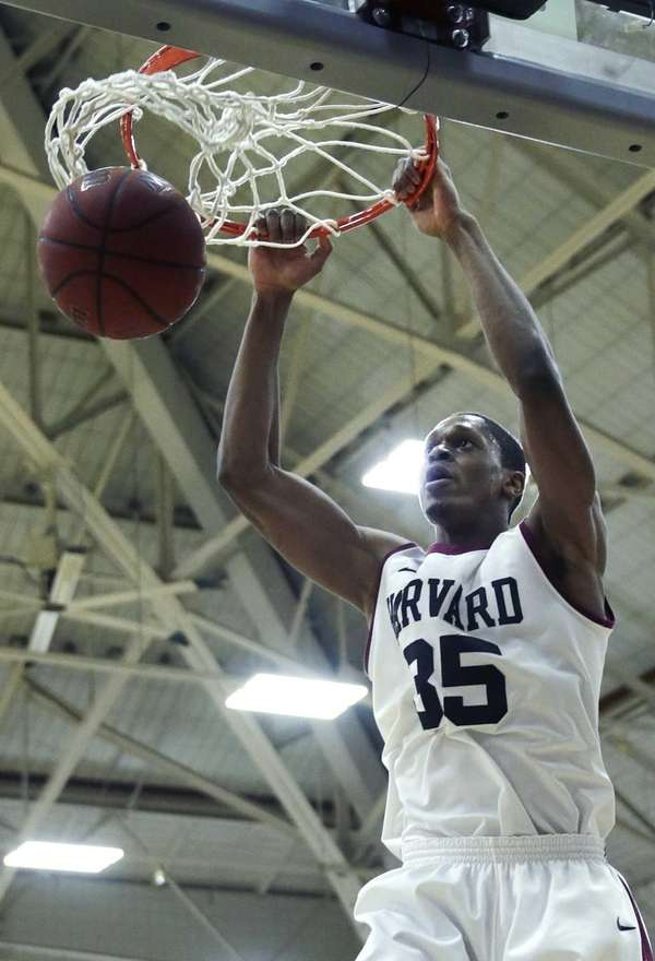 Harvard guard Agunwa Okolie slams a dunk against