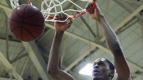 Harvard guard Agunwa Okolie slams a dunk against