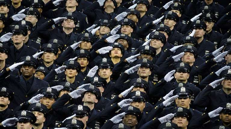 New recruits raise their heads and salute during