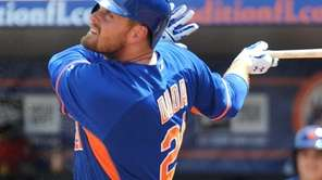 Lucas Duda swings during a spring training game