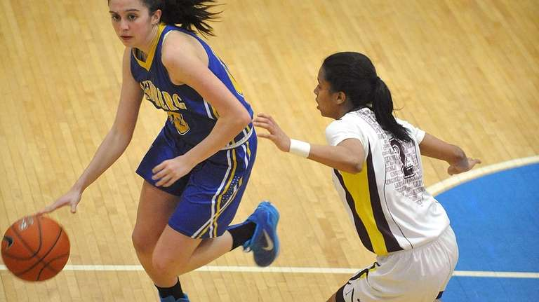 Kellenberg's Kate Calabro, left, gets pressured by Nazareth's