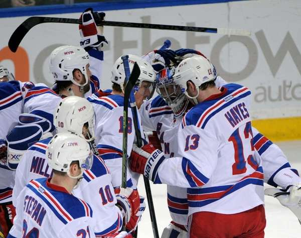New York Rangers celebrate with goaltender Mackenzie Skapski