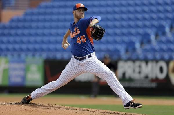 New York Mets pitcher Zack Wheeler delivers a