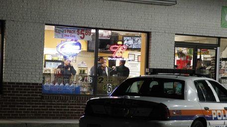 Nassau Police investigate the scene at a gas