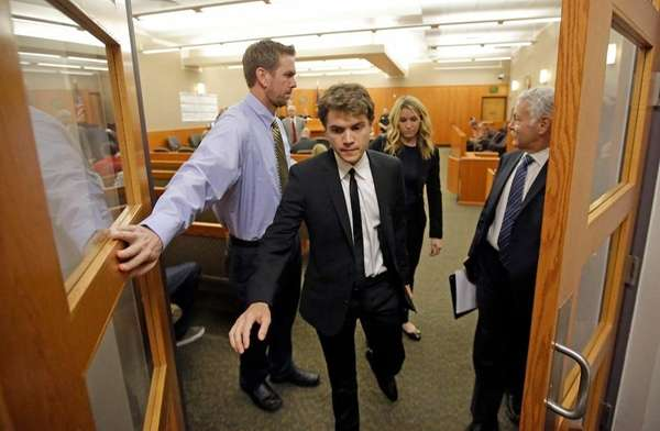Actor Emile Hirsch, center, leaves court, Monday, March