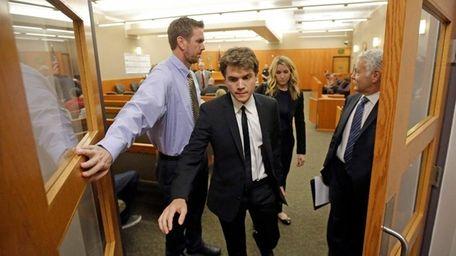 Actor Emile Hirsch, center, leaves court, Monday, March