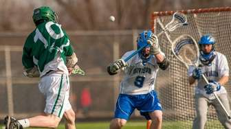Seaford's Bobby Buell, left, takes a shot on