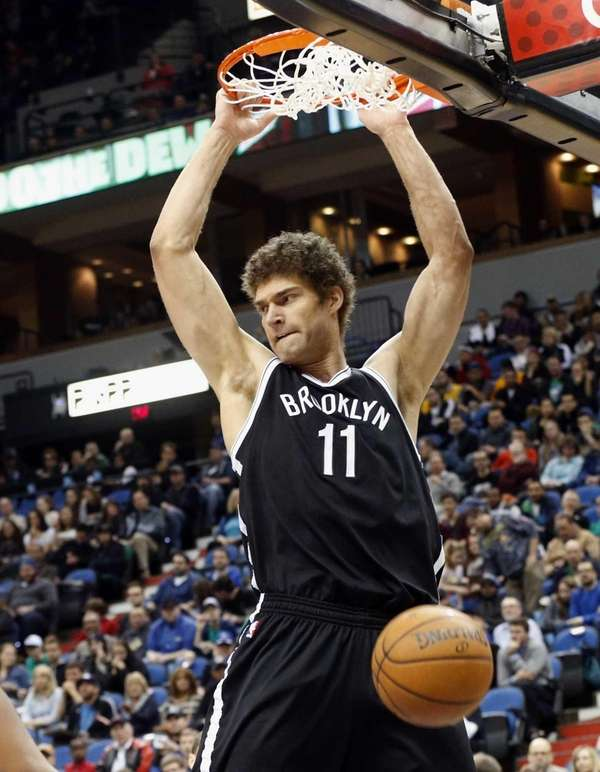 Brook Lopez dunks against the Minnesota Timberwolves in