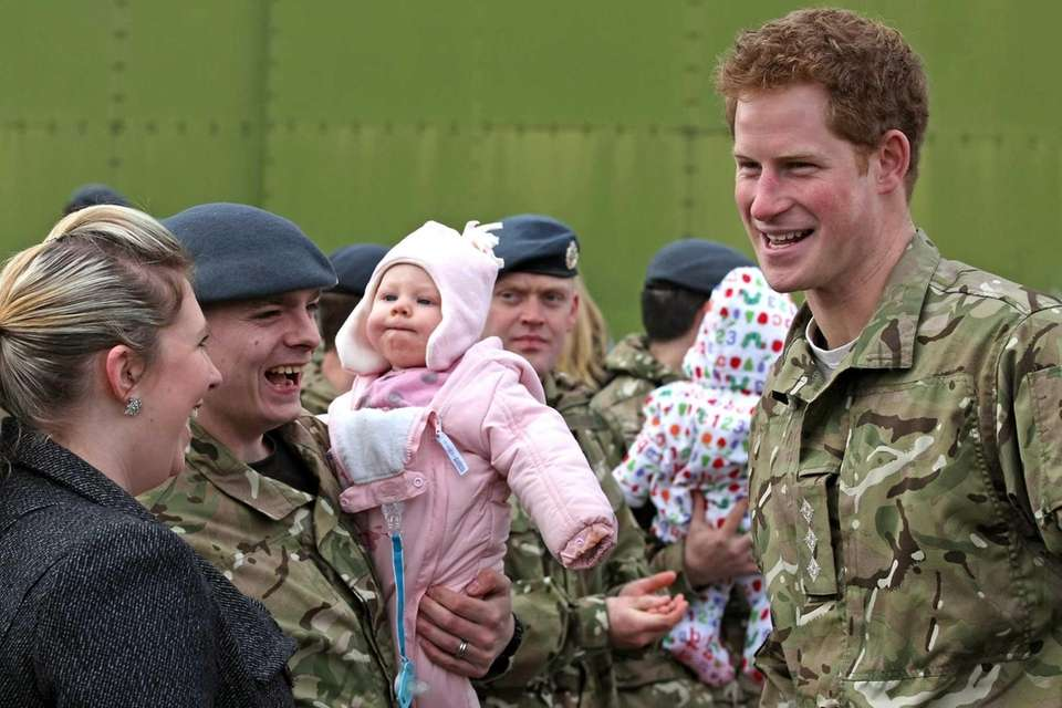 Prince Harry chats with Sean and Katie Thompson,