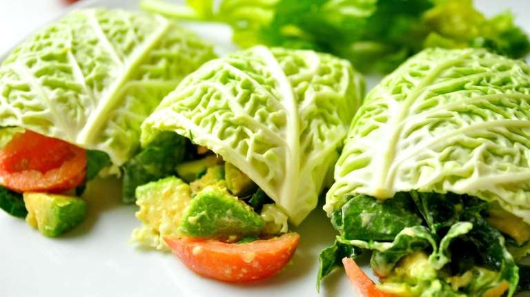Raw food diet concept with cabbage wraps filled