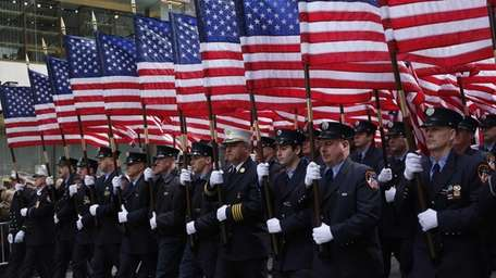 Members of the NYPD march in the 245th