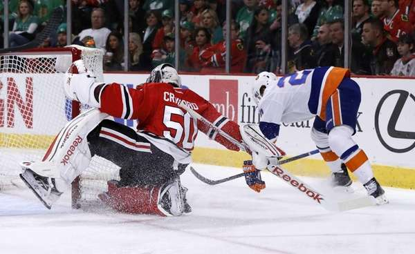 Chicago Blackhawks goalie Corey Crawford spins around the