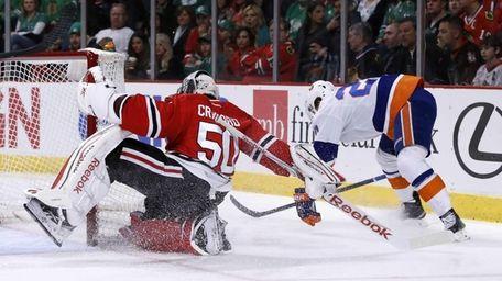 Chicago Blackhawks goalie Corey Crawford spins around the