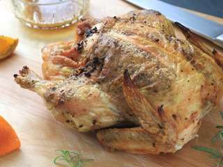 Garlic-rosemary-orange roasted chicken is a dinner recipe that's