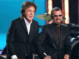 Paul McCartney, left, and Ringo Starr appear at