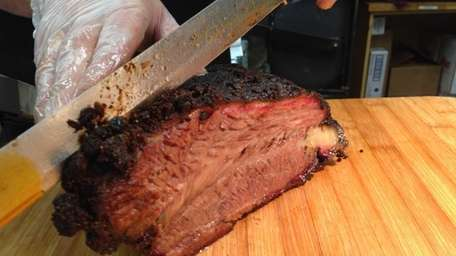 Bob Cozzens, pitmaster at Best Yet Market in
