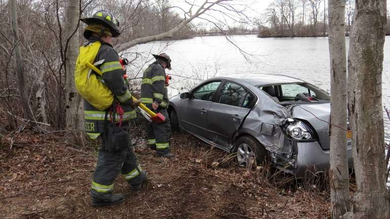 Wantagh firefighters inspect a car after its driver