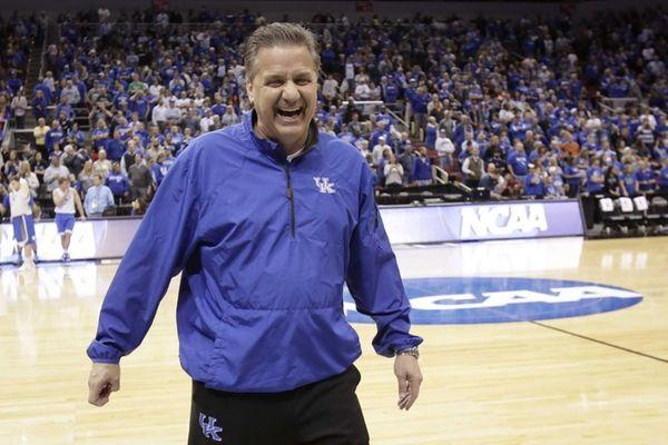 Kentucky head coach John Calipari jokes around with