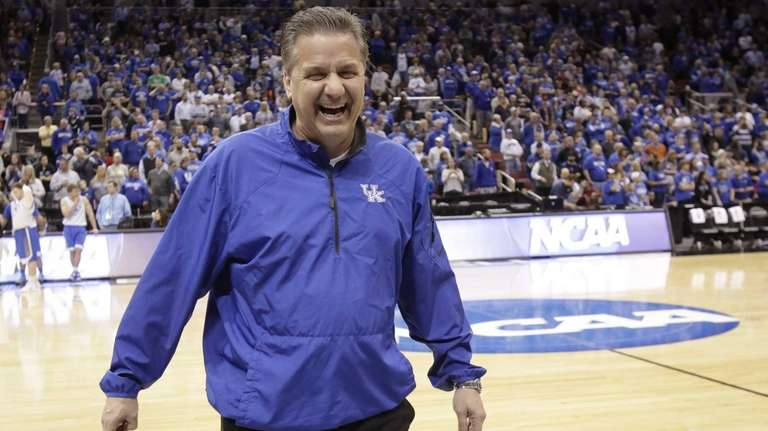 Kentucky head coach John Calipari jokes around with