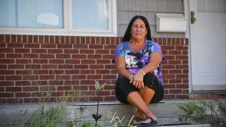 Susan Gorman sits on the porch of her