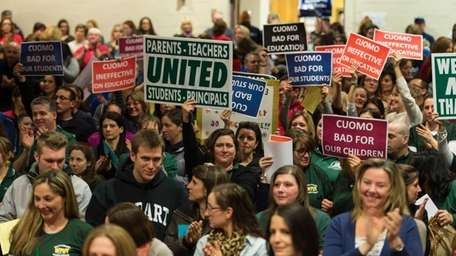 Teachers, parents and school administrators rally against what