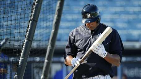 The Yankees' Alex Rodriguez inspects his bat after