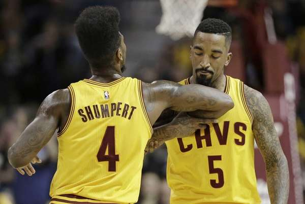 The Cleveland Cavaliers' Iman Shumpert congratulates teammate J.R.