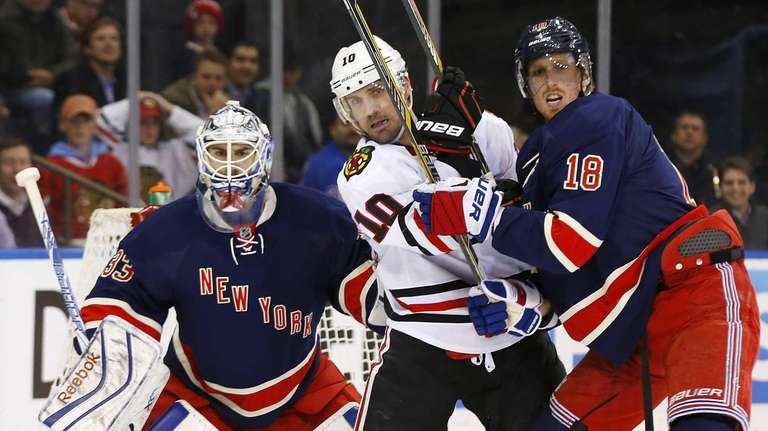 Marc Staal and Cam Talbot of the New