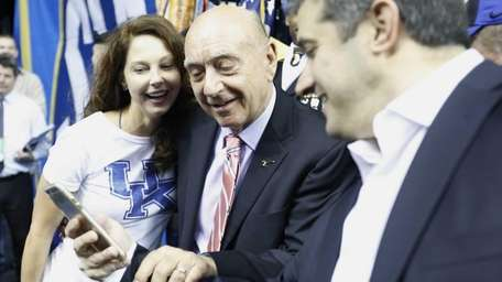 Actress Ashley Judd, left, and broadcaster Dick Vitale,