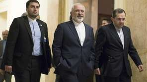 Iran's Foreign Minister Mohammad Javad Zarif, center, walks