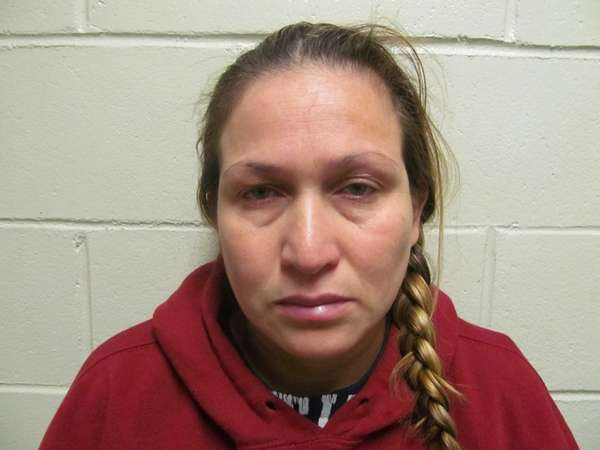Norma Espinoza, 37, of Glen Cove, was charged