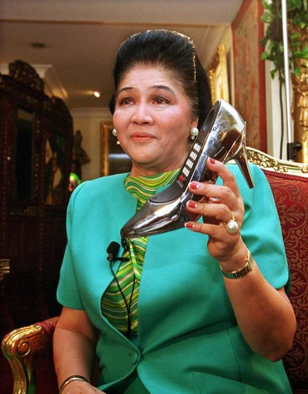 Former First Lady Imelda Marcos shows a telephone