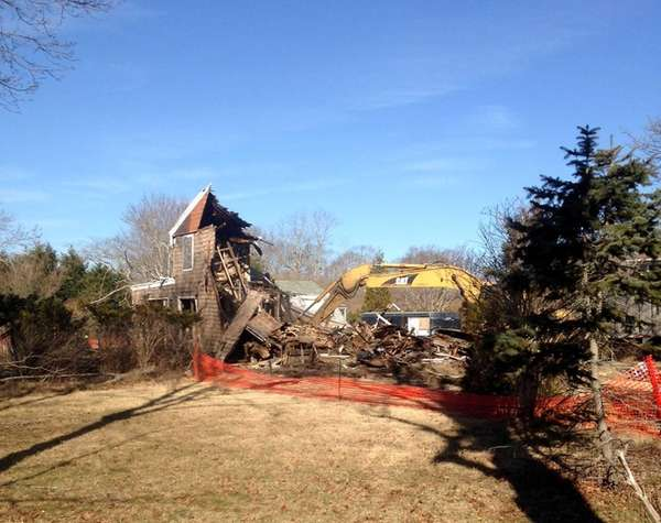 An abandoned house in Westhampton Beach is demolished