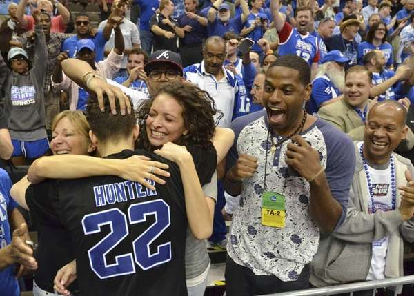 Georgia State's R.J. Hunter (22) celebrates with fans