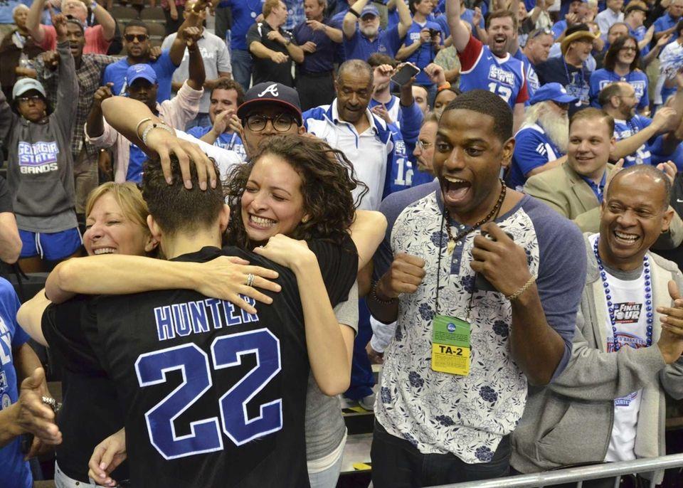 Georgia State's R.J. Hunter (22) celebrates with fans