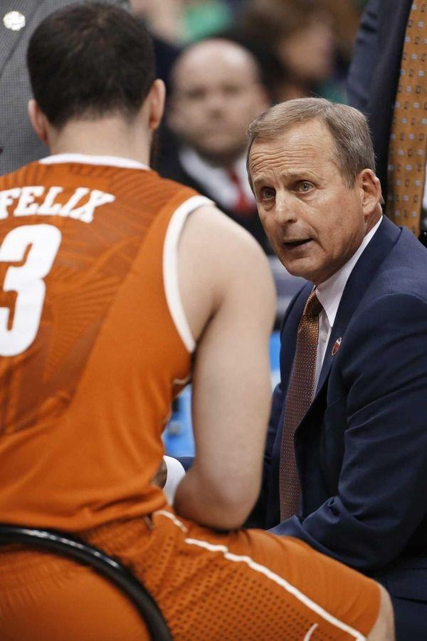 Texas head coach Rick Barnes talks with Javan