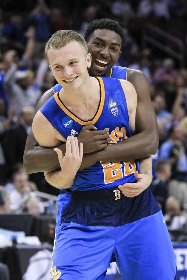 UCLA guard Bryce Alford is hugged by guard