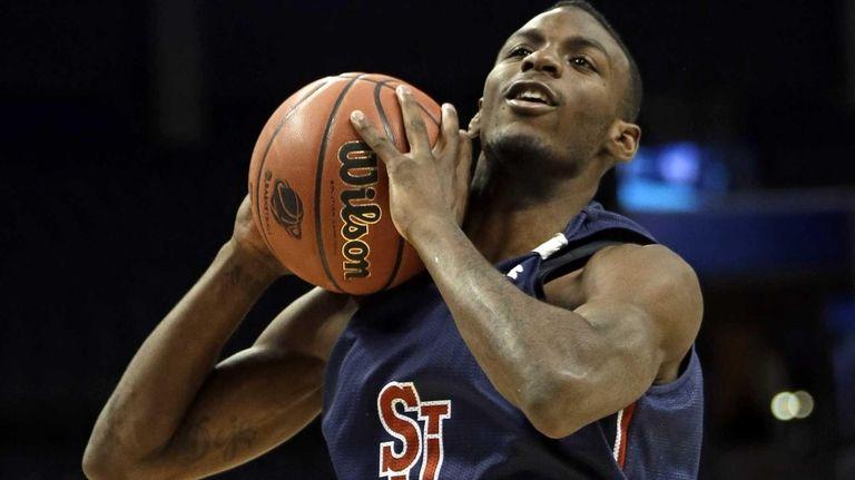 St. John's Rysheed Jordan grabs a rebound during